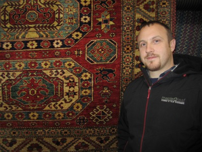 Picture of Maple Leaf company owner Clint West with rug
